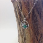 Hand cut chrysoprase stone set in fine silver, abstract mountain pendant