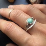 Various stacking rings: rose gold midi-ring, small round turquoise ring with rose gold details, silver 'twiggy' ring