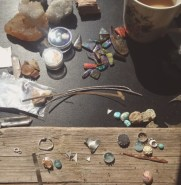 My messy work bench! Gemstones, cabochons, silver bits and pieces, vintage coffee mug, crystals