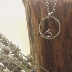 Sterling Silver Braid Karma Loop Pendant with faceted amethyst gemstone, rose gold detail